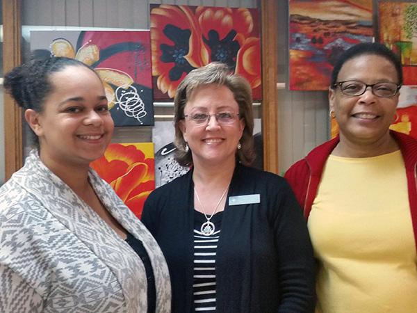 Carol Landreau (Wellness Coalition Wellness Navigator) with Resurrection Catholic Church Lay Leaders Michelle Coe (left) and Wanda Twitty (right)