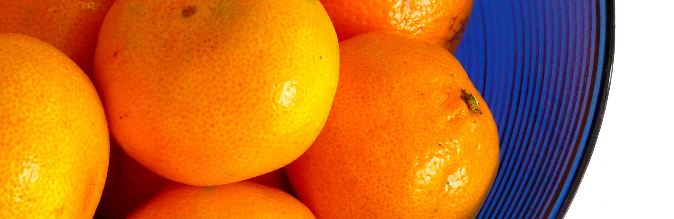 a close up of a bunch of oranges