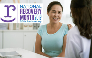 Woman smiling at another woman with a title National Recover Month 2019, 30th Anniversary.